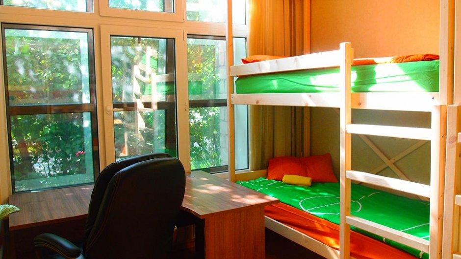 Восьмиместный номер с двухъярусными кроватями